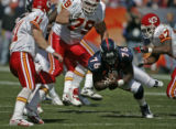 Denver Broncos Kenard Lang grabs a Damon Huard fumble only to lose it in the first quarter against...
