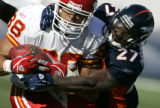 Denver Broncos Darrent Williams tackles Kansas City Chiefs Tony Gonzalez to stop the Chiefs on...