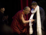 Denver Mayor John Hickenlooper, right, shakes hands with Tenzin Gyatso, the XIVth Dalai Lama,...