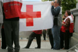 Red Cross employees and volunteers join with representatives from other relief agencies on the...