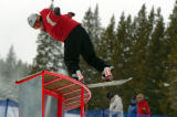 (BRECKENRIDGE, Co., SHOT 11/12/2004) Jon Raevsky, 19, of Breckenridge nose presses a u-shaped rail...