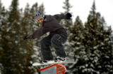 (BRECKENRIDGE, Co., SHOT 11/12/2004) Casey Hickens, 19, of Breckenridge pops off a u-shaped rail...