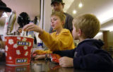(DENVER , Colo, November 17, 2004) Martin Pyykkonen drops 31.25 on food for him and his two boys...
