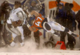(DENVER, CO., NOVEMBER 28, 2004)  Denver Broncos #47, John Lynch, right, goes high but is flipped...