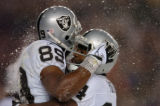 (DENVER, CO., NOVEMBER 28, 2004) Oakland Raiders # 89, Ronald Curry, left, celebrates his fourth...
