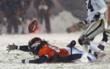 Denver, Colo., photo taken November 28, 2004- Denver's Dwayne Carswell looses the ball but was...