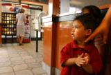 (Denver, Colo., May 24, 2004) Jorge Reyes, 2, waits in line at the McDonald's next to a machine...
