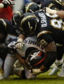 (San Diego, CA, December 5, 2004)  Jake Plummer is sacked by the Chargers defense in the second...