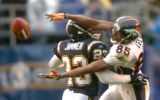 [(Denver, CA, Shot on: 12/5/04)] Denver Broncos Ashley Lelie can't haul in a pass but picks up a...