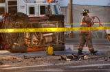 Englewood, Colo., photo taken December 5, 2004- Fire and rescue crews try to clear the scene of an...