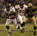 New Orleans Saints Darren Howard, #93, chases Denver Broncos Reuben Droughns, #34, in the second...