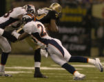 Denver Broncos Champ Bailey, right, tackles New Orleans Saints Boo Williams with Broncos Reggie...