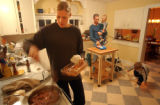 [(Durango, CO, Shot on: 11/22/04)] Becca James stirs grass fed beef while her husband Dan helps...