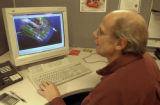 (Frederick, Colo. Nov. 23, 2004) Phil Caffery, a mechanical desinger at UQM Technologies, works on...