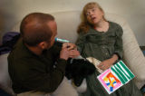(11/04, Boulder, CO)  Cathy Rich, who is deaf and blind and suffers from Cerebral Palsy, sits on a...