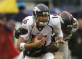 (San Diego, CA, December 5, 2004)  Jake Plummer is sacked in the second quarter of the Denver...