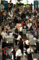 (Denver, Colo., November 24, 2004) Airline travelers go through security at DIA on Wednesday,...