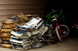 (FT COLLINS, Colo., November 24, 2004) Piles of papers and bikes align the hallway of one of the...