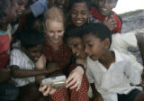 (1/25/05, Pondicherry, India)  Dawn Anderson looks over digital images with kids from the village...