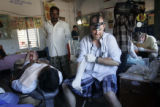 (1/25/05, Pondicherry, India)  Dentist Scott Tidwell gets ready to pull a man's molar.  The Dalit...