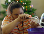 (Denver, Colo., December 10, 2004)  Suzette Moseman makes banana bread during a cooking activity...
