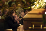 (12/10/2004) Littleton, Colorado-Marla Sewell, of Littleton,Colo., comforts her daughter Brooke,...
