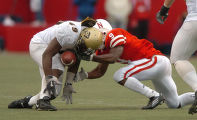 (Lincoln Nebraska, Nov. 26, 2004)  Thaddaeus Washington intercepts a pass intended for Nebraska's...