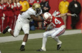 (Lincoln NB, November 26, 2004)  Brian Iwuh tackles Stewart Bradley in the second quarter of CU...