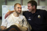 (Denver, Colo., 1/25/05- Jamin Camp (left) and Denver police Sgt. Greg Jones (right) share a...