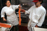 (DENVER, Co., SHOT 11/22/2004) Rioja co-owner and sous chef Dana Rodriguez (left) hands the spine...