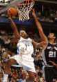 Denver, Colo., photo taken November 26, 2004-Nuggets forward, Carmelo Anthony (left), slips past...