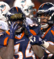 (Denver, Colorado, Dec. 12, 2004) Reuben Droughns helmet is covered with turf in the closing...