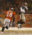 Oakland Raiders Ronald Curry, 389, pulls in a pass for 63 yards against Denver Broncos safety...