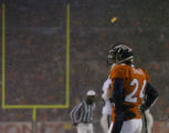 Denver Broncos cornerback Champ Bailey stand in the end zone, hand on hips after Oakland Raiders...