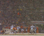 Amid a flurry of snow, Oakland Raiders rush Denver Broncos quarterback Jake Plummer in the third...