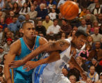 Denver, Colo., photo taken November 29, 2004-Nuggets forward/center, Marcus Camby (right) fights...