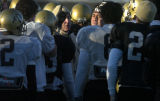 University of Colorado football coach Gary Barnett talks to his players at the Buffaloes football...