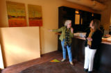(DENVER, Co., SHOT 11/17/2004) Jan Young (left), a Denver artist, shows two of her paintings to...