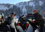 (11/30/2004) Backcountry skiers Polly Simpich, Frasier, and Karin Kean, Frasier, hitch a ride to...