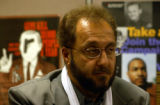(DENVER, Colo., November 30, 2004) Ibrahim Kazerooni listens at a press conference. (cq, Kazerooni...