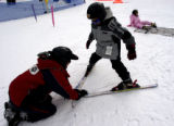 (Keystone, Colo., 12/10/2004) Roberto Moreno, who runs a ski program for inner-city children...