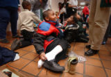 DENVER, CO - DEC. 15, 2004   Michael Gaither, 6, tries on a new pair of shoes Wednesday morning,...