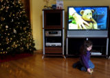 (12/01/2004)Denver-Jessica Cordova, 3, plays with a reindeer ornament while visiting Listen Up on...