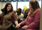 (12/01/2004) Denver, Colorado-Jeanne White, left, mother of AIDS activist Ryan White, holds hands...