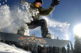 (11/30/2004) Matthew Parks, 15, on vacation from Oklahoma, practices his snowboarding at the top...