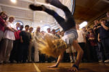 (Denver, Colo., December 16, 2004) 7th grade student Audrey hagman, 12, does a backflip while...