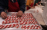 (DENVER , Colo., December 6, 2004)   Candy canes are placed on a tray at Hammond's Candies in...