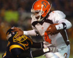 OHJP101 - Bowling Green quarterback Omar Jacobs breaks the tackle of Toledo's Anthony Jordan,...