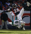 (December 12, 2004) -- Denver Broncos Kenoy Kennedy, #28, knocks Miami Dolphins tight end Randy...