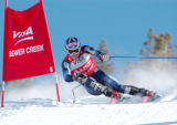 Bode Miller blasts down the 2004 Birds of Prey Ski World Cup Downhill course on his way to...